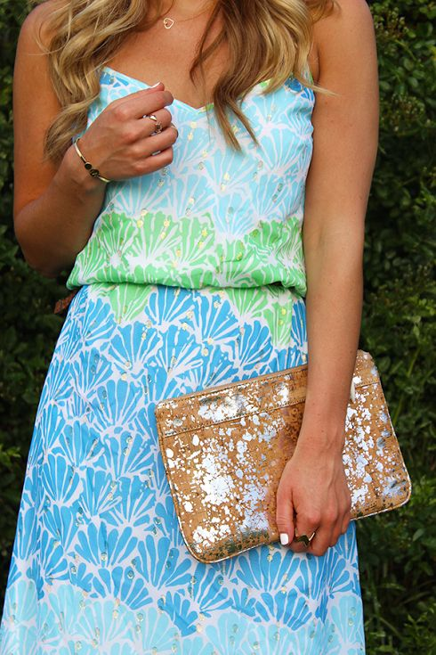 girl in blue and green Lilly Pulitzer dress and gold clutch