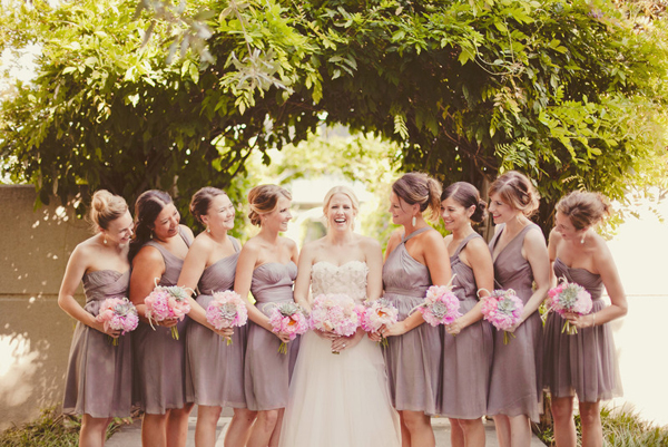 grey bridesmaid dresses and pink bouquets