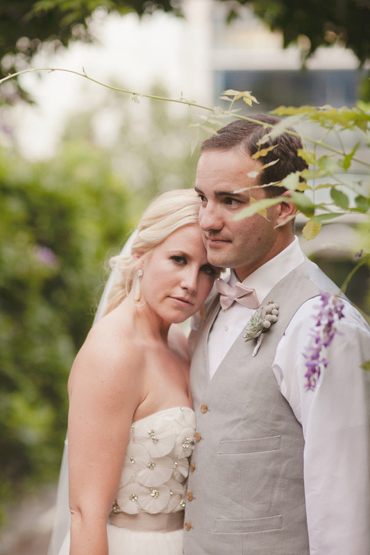 bride resting head on grooms chest