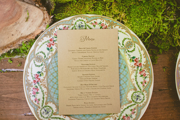 wedding menu on top of pink and gold floral plate