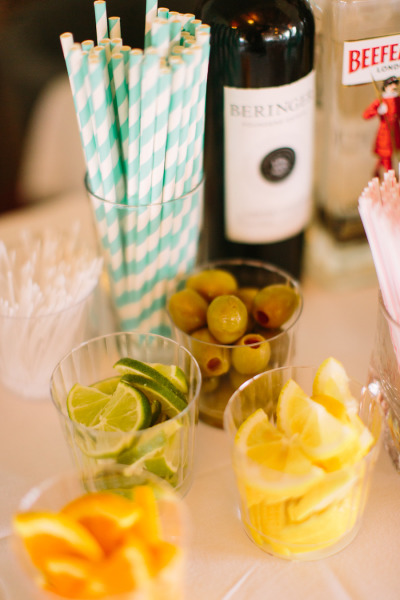 cocktail garnishes and striped blue straws
