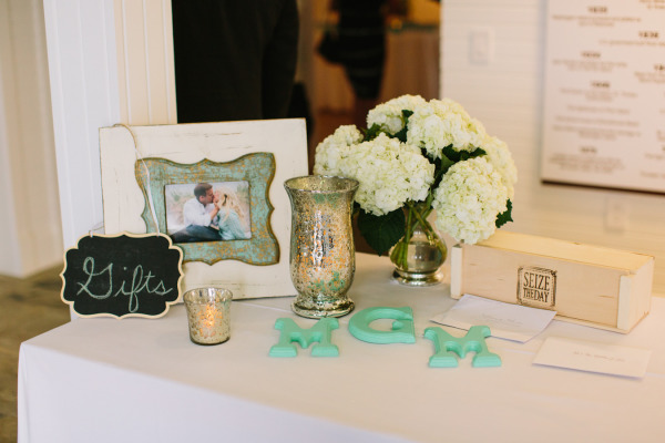 wedding gifts table with a framed photo of teh couple and hydrangeas