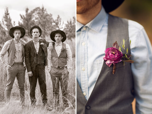 groomsmen posing with top hats standing in tall grass