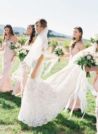 Bride In Ines Di Santo Wedding Dress And Bridesmaids Walking By Vineyard