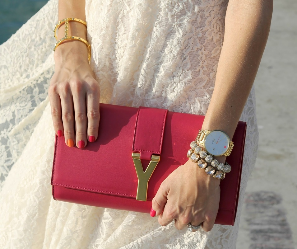hot pink YSL clutch and gold jewelry