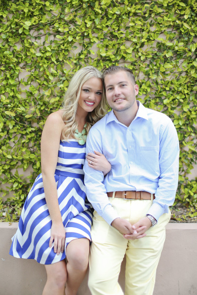 engagement photo, girl in striped dress and statement necklace and guy in blue dress shirt