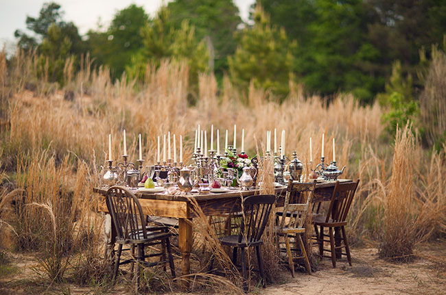 vintage table setting outside with silver candelsticks
