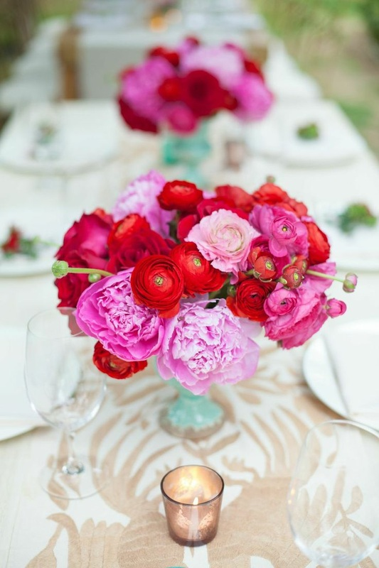 pink and red wedding flowers in light blue vase