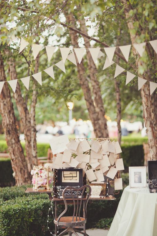 typewriter and notes on a table outside for guests to write notes