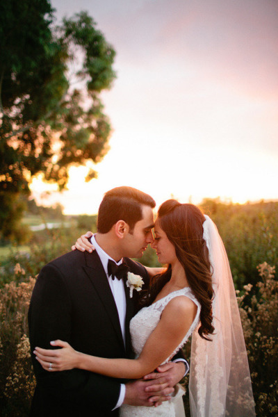 bride and groom looking at each other during golden hour