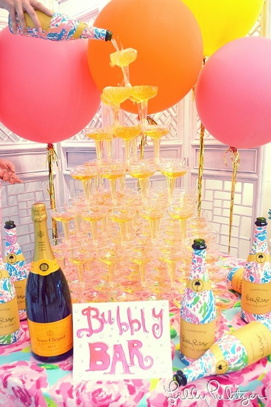 stack of champagne glasses, bubbly bar wit balloons