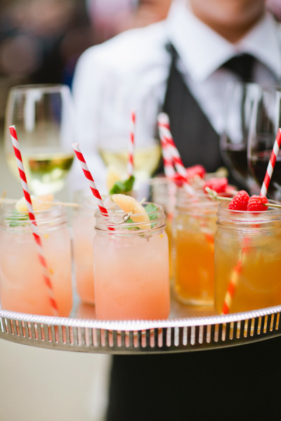 peach drinks with red striped straws