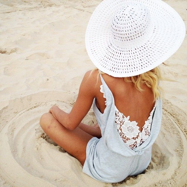 tan girl in floppy white hat and light blue romper