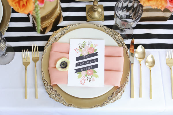 the blusjing bride card with gold charger, gold silverware and navy striped table runner