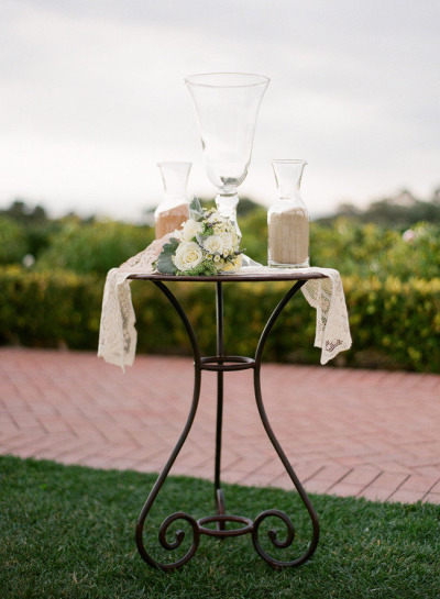 sand ceremony set up on table with white roses