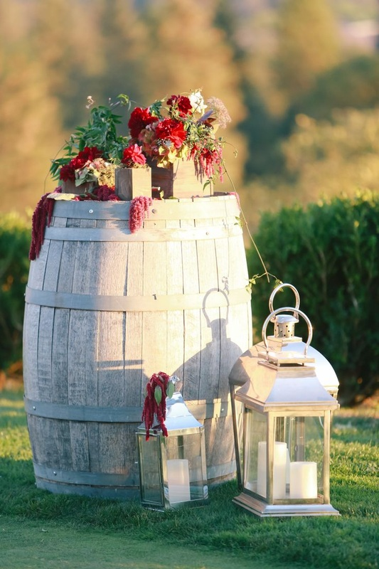 wedding barrel with red wedding flowers on top