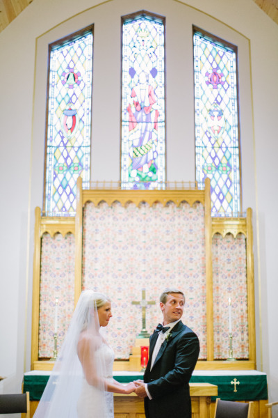 bride and groom at alter in a church