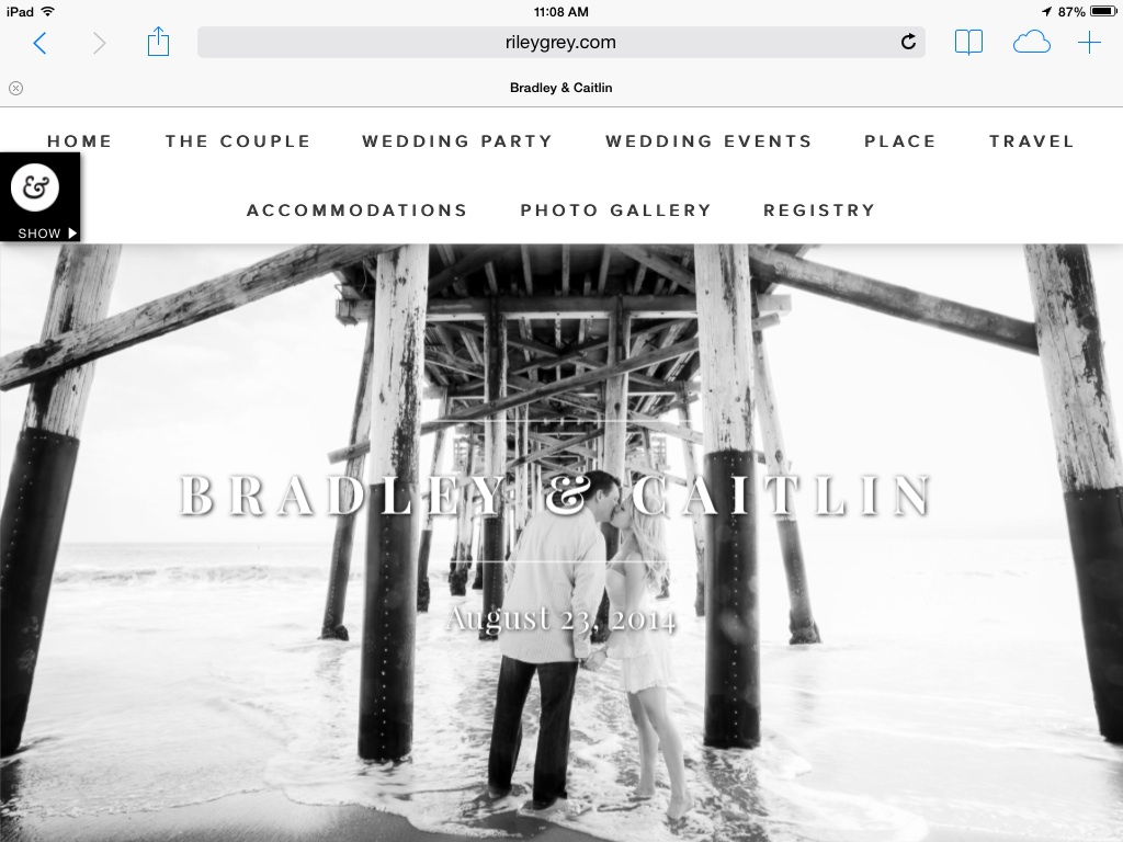 wedding website created on Riley and Grey home page image of nearly weds kissing under dock