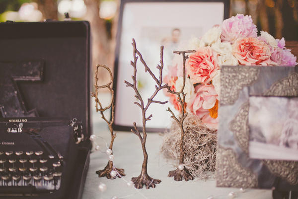 table with pictures of the bride and groom and small wedding bouquet