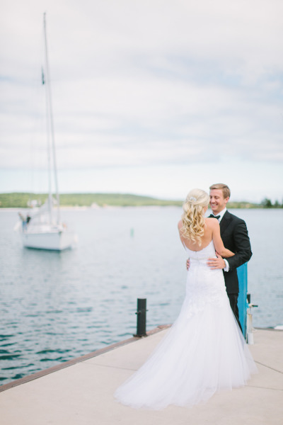 bride and grooms first look on a dock