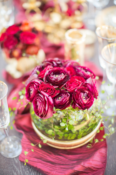 Marsala red wedding flowers with gold table settings