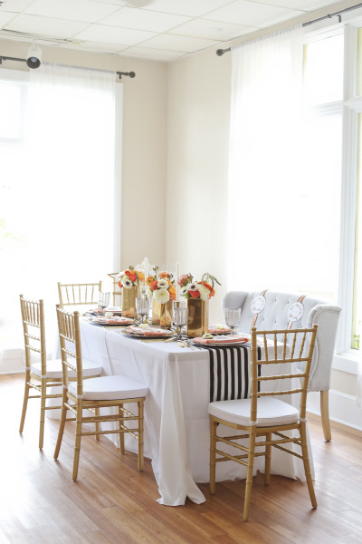 styled engagement table with gold chairs and a nautical table runner