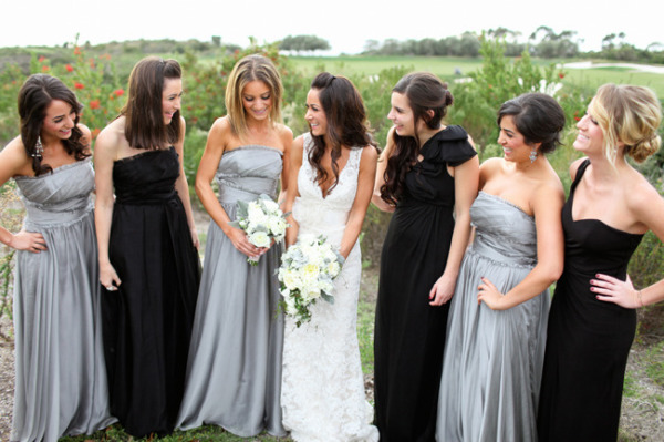 bride standing with bridesmaids in silver and black bridesmaid dresses