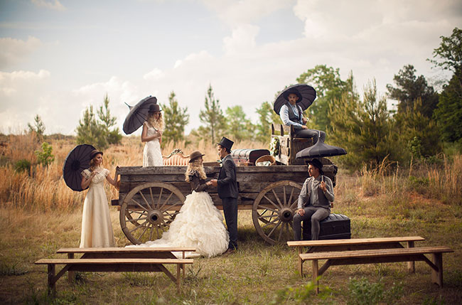 vintage wedding ceremony with wagon and vintage benches