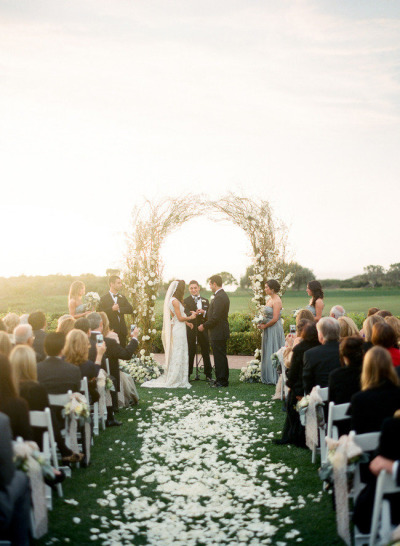 bride and groom at wedding alter next to stunning wedding arbor