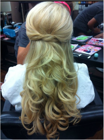 wedding hair half up do with a pouf and twisted knot and down in curls