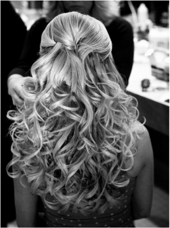 curly wedding hair with hair half up