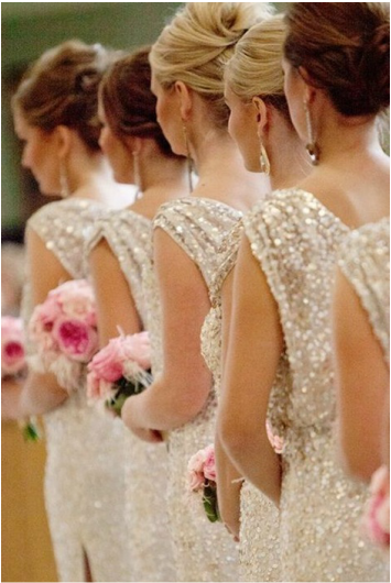 bridesmaid standing during the ceremony in light sequin dresses with keyhole back