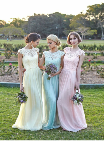 bridesmaid outside in flowing dresses and lace cap sleeve necklines with each dress a different color: yellow, mint and pink