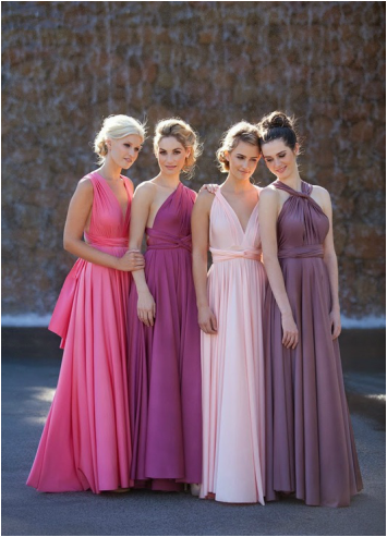 bridesmaids in ombe colors from drark purple to light pink all in long wrap bridesmaid dresses