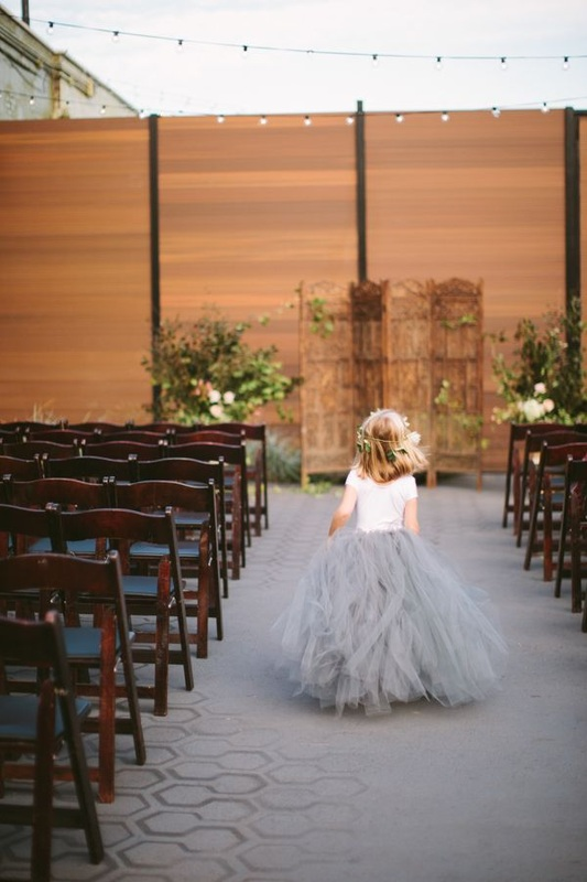 flower girl in grey tulle skirt
