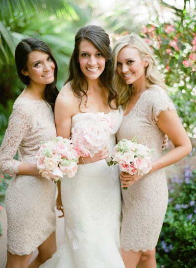 bride next to bridesmaids in nude lace short dresses