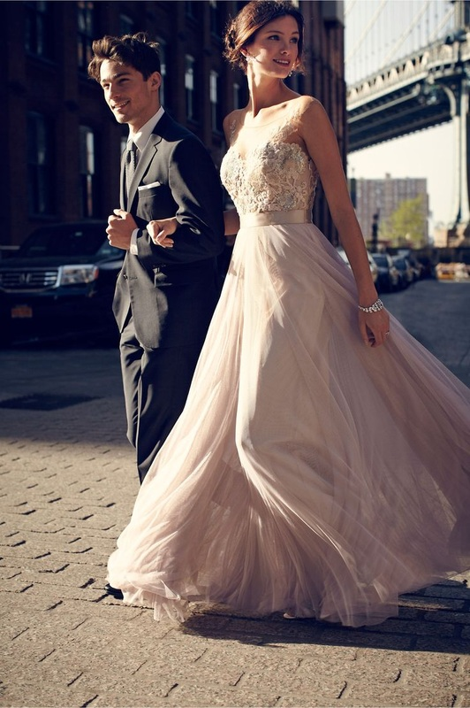 couple outside and girl in flowy nude dress with strapless embellished top