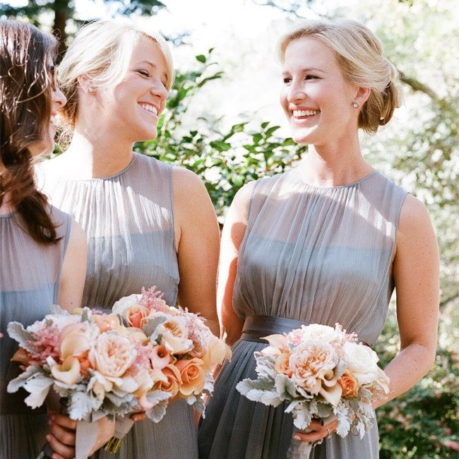 bridesmaids in dusty blue bridesmaid dresses with sheer illusion top