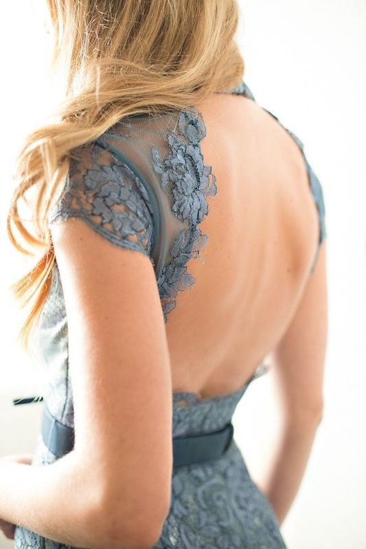 girl in lace blue dress with keyhole back