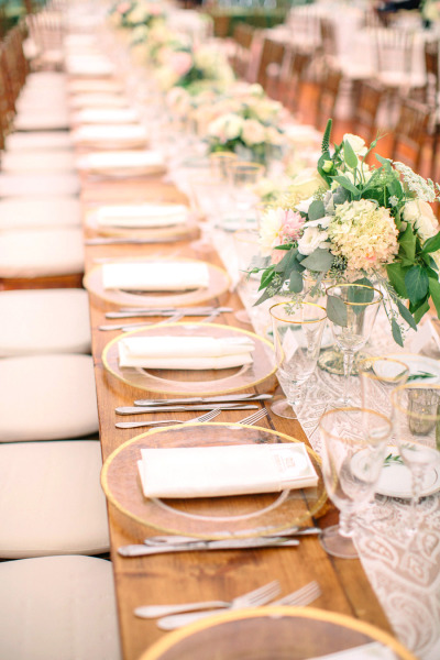 reception kings tables with burlap table runner and pink, white, yellow and green wedding flowers
