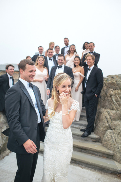 black tie bridal party outside laughing