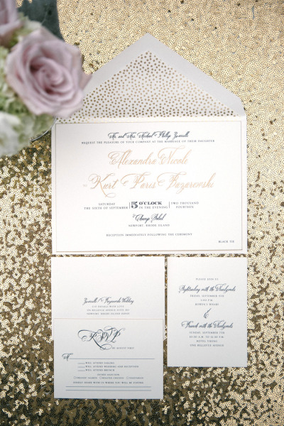 gold and black modern wedding invitations on gold sequin linens