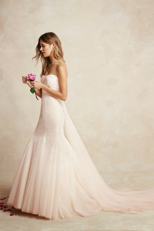 Monique Lhuillier fitted strapless fit and flare wedding dress