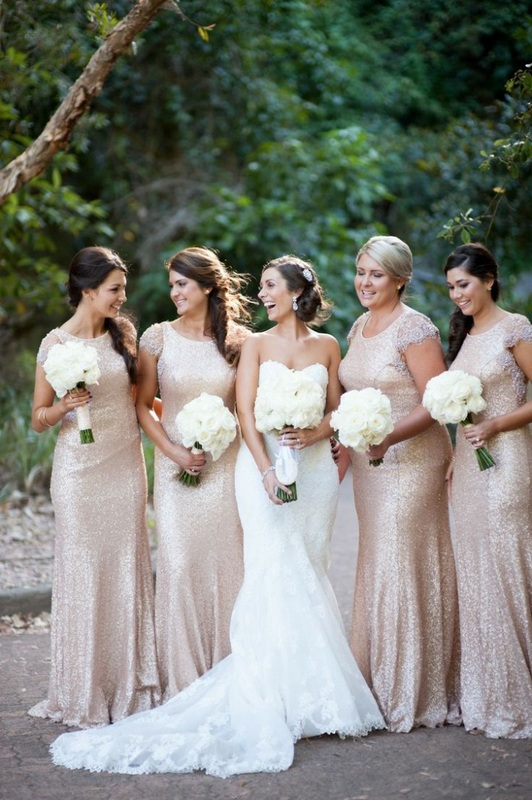 bride standing next to bridesmaid in gold dresses with cap sleeves