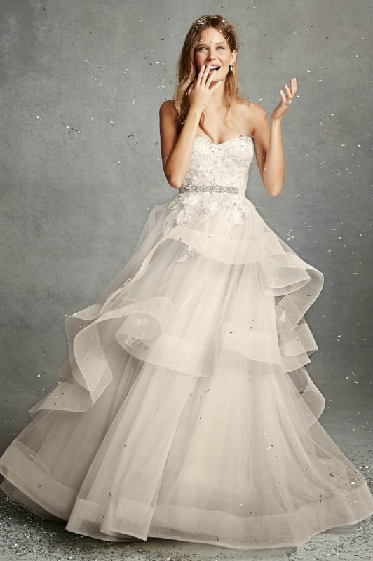 Monique Lhuillier strapless ballgown wedding dress with flowing skirt