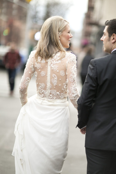 bride and groom walking outside in nyc