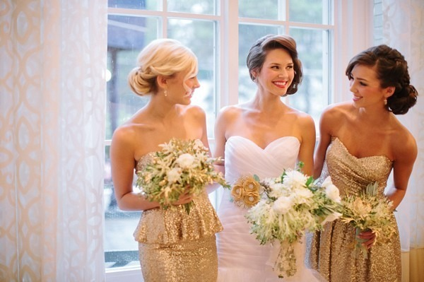 bride next to bridesmaids in strapless gold sequin dresses