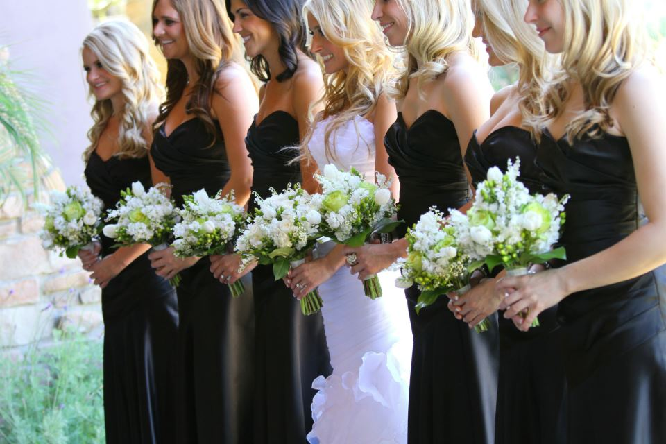 bride in between bridesmaids in black long strapless bridesmaid dresses