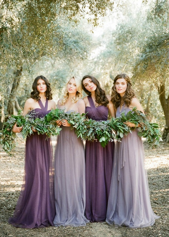 bridesmaids in dark purple and lilac bridesmaid dresses