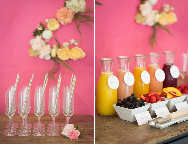 bridal shower mimosa bar with fruits and a variety of juices